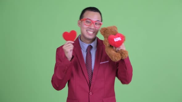 Thumbnail for Happy Asian Businessman with Eyeglasses Ready for Valentine's Day