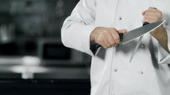 Thumbnail for Chef Hands Sharpening Knife in Slow Motion. Closeup Hands Cook Food at Kitchen