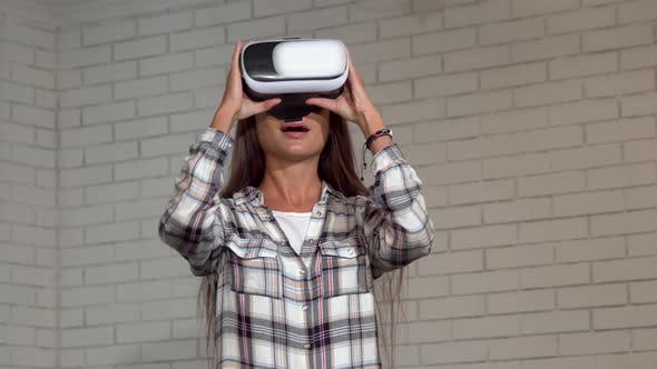 Thumbnail for Attractive Young Woman Looking Excited, Using Virtual Reality Glasses