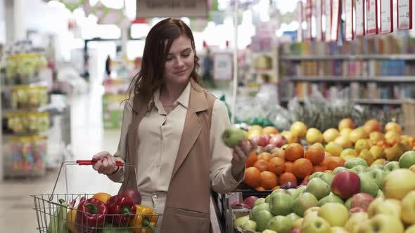 Thumbnail for Retail Store, Beautiful Smiling Shopper Woman with Shopping Basket Chooses Eco-friendly Products