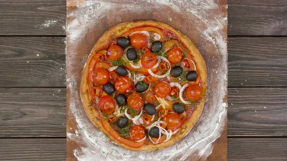 Thumbnail for Top View of Vegetarian Pizza Eating on Wooden Plate, Stop Motion Animation