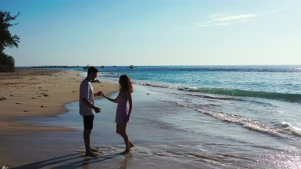 Thumbnail for Happy man and woman after marriage in love spend quality time on beach on paradise white sand backgr