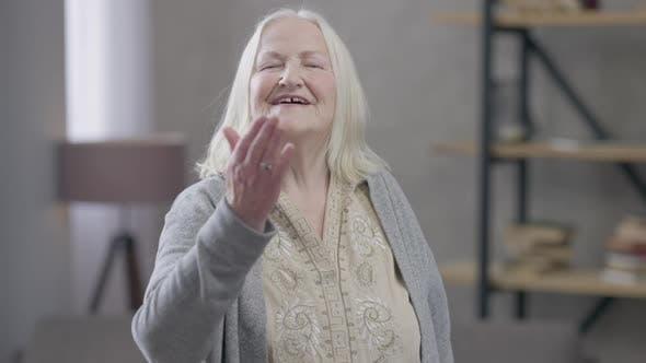 Smiling Old Woman Sending Air Kiss Looking at Camera Smiling