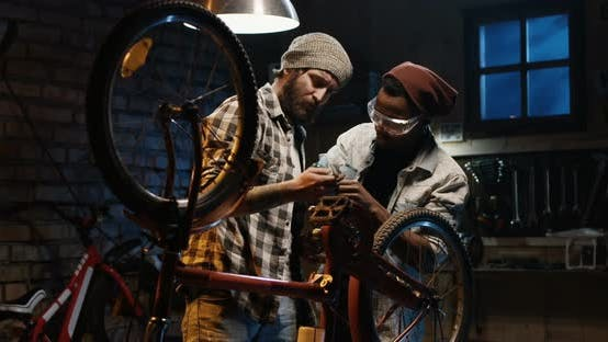 Thumbnail for Two Mechanic Repairing a Bicycle