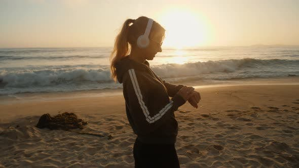 Listening To Music On The Beach