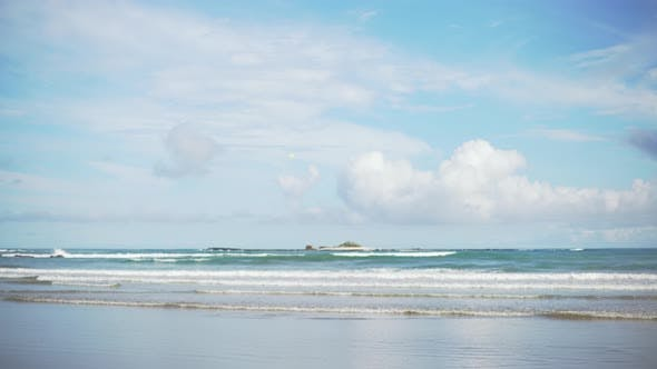 Thumbnail for Wide shot of beautiful clouds over calm sea waves on tropical beach