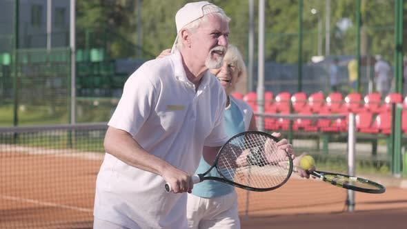 Thumbnail for Happy Adult Couple Playing Tennis on a Sunny Day
