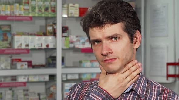 Thumbnail for Handsome Young Man Coughing Having Sore Throat Standing at the Pharmacy