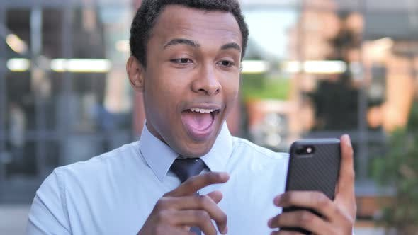Thumbnail for Wow, African Businessman Surprised on Smartphone