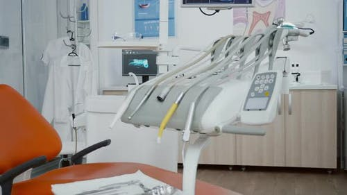 Close Up Revealing Shot of Medical Orthodontic Display with Teeth Xray Images