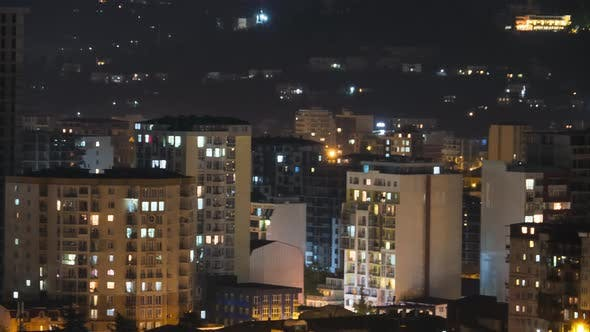 Multistorey Buildings with Changing Window Lighting At Night in City. Timelapse