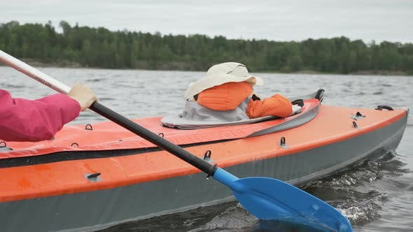 Thumbnail for Little Child Sails in Kayak with Happy Mother on Large Lake