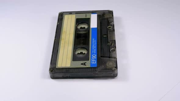 Cover Image for Vintage Audio Cassette Rotates on White Background