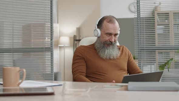 Thumbnail for Businessman Listening to Music in Office