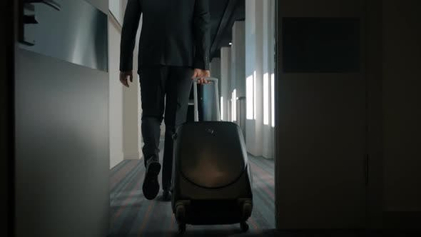 Thumbnail for Businessman with Travel Suitcase Walking at Hotel Corridor. Man Arriving Hotel