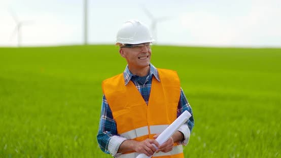 Cover Image for Male Engineer Working While Holding Blueprint
