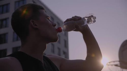 Man Drinking Water From the Bottle After Workout