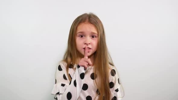 Thumbnail for Cute Blonde Teenage Girl Making Gesture of Silence. Irritated Face Shushing