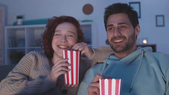 Couple Laughing at Movie They Watching
