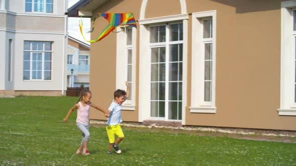 Thumbnail for Children Flying Colorful Kite