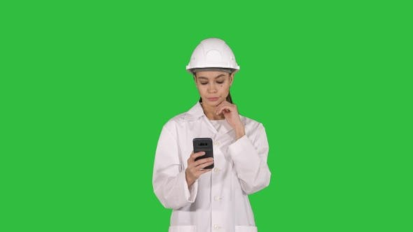 Cover Image for Scientist Using Phone Texting Message on a Green Screen