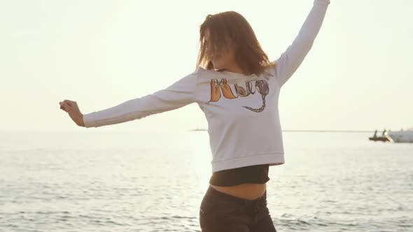Joyful Woman Is Whirling on Sea Beach in Sunshine