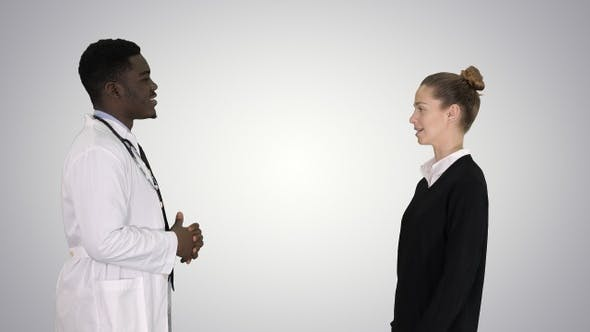 Cover Image for Acquaintance doctor with a patient on gradient background.