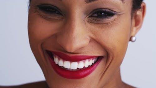 Happy black woman smiling and looking at camera