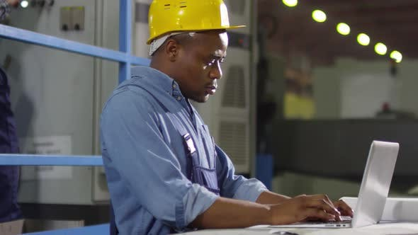 Thumbnail for Thoughtful black technician working on laptop
