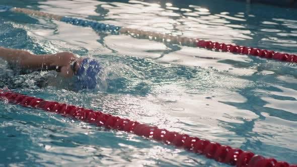 Slowmo of Female Swimmer Practicing Backstroke