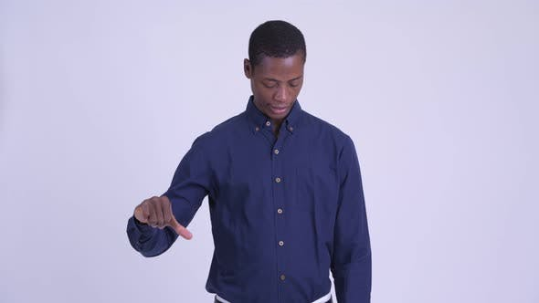 Thumbnail for Young Stressed African Businessman Giving Thumbs Down