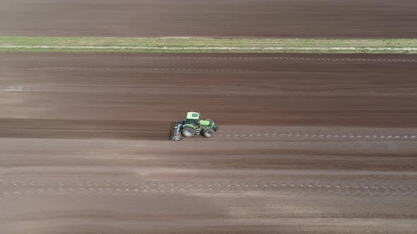 Thumbnail for Tractor with Harrows on the Farmland