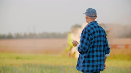 Thumbnail for Farmer Using Digital Tablet Agriculture