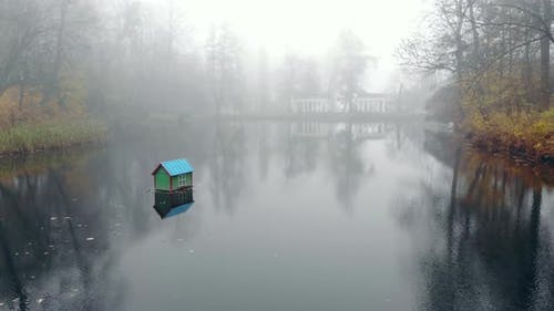 Fog Over the Lake in the Autumn Park