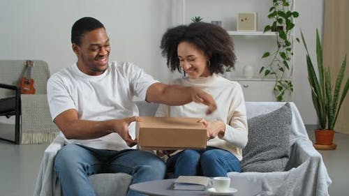 Afro American Couple Black Husband and Wife Consumers Buyers Receive Parcel By Mail From Internet