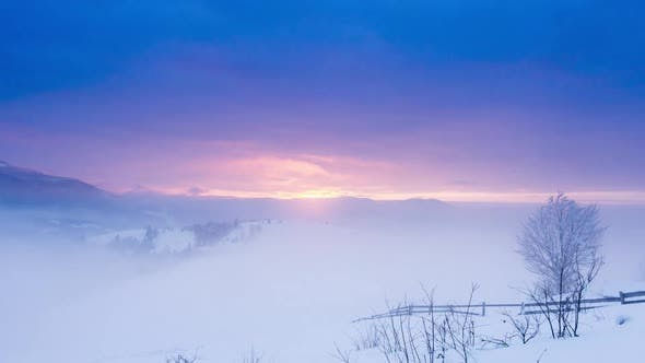 Mountain Peak with Snow Blow By Wind