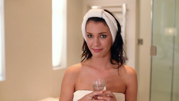 Thumbnail for Beautiful Brunette Wearing A Towel Drinking