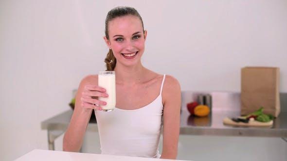 Smiling Model Drinking Glass Of Milk