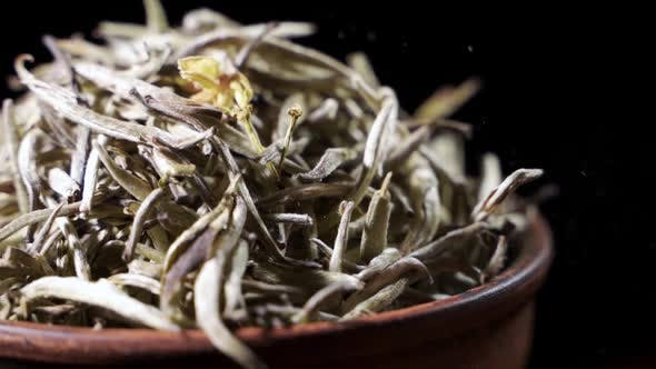 Thumbnail for Tea Leaves Fall on a Pile of a Green Tea - Macro Shot.