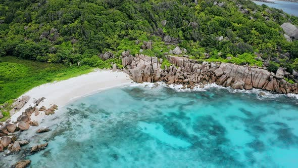 Thumbnail for Aerial Drone Video of Seychelles Most Beautiful Idyllic Tropical Beach Anse Marron at La Digue