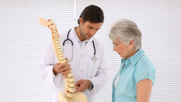 Thumbnail for Chiropractor Explaining Spine Model