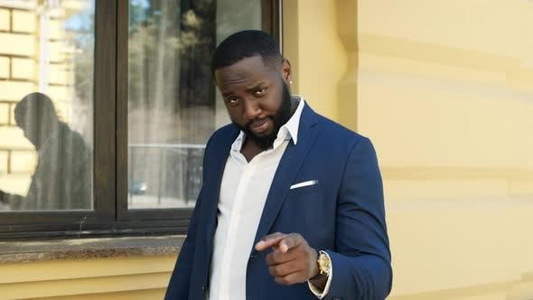 African Business Man Talking Emotionally