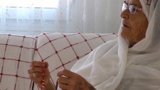 Thumbnail for Old Woman Prays with Rosary 4