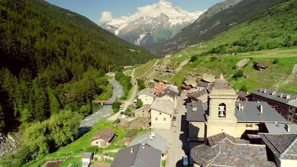 Thumbnail for Aerial view of Lanslebourg village and snow peak mountain, Savoie, France.