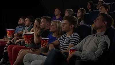 Young People Watch Movies in Cinema: Horror