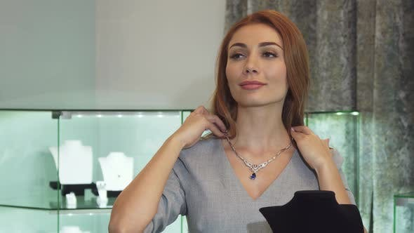Thumbnail for Young Sexy Woman Trying on Diamond Necklace at the Jewelry Store
