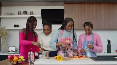 United African American Family Cooking in Domestic Kitchen