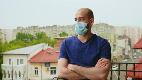 Sad Man with Disposable Mask