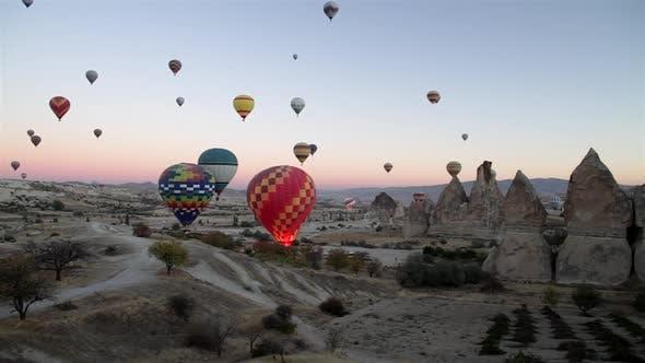 Hot Air Balloons over Valley in Cappadocia, Turkey.