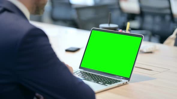 Thumbnail for Businessman Using Laptop with Green Chroma Screen